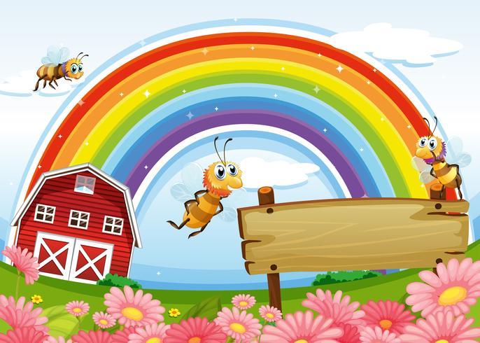 Een boerderij met een leeg houten bord en een regenbooghoog