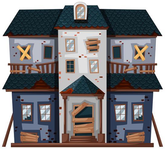 Antigua casa con ventanas rotas y puerta.