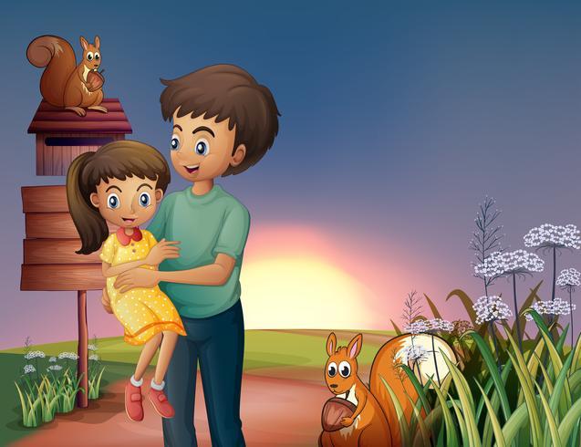 Een vader met zijn dochter op de heuveltop