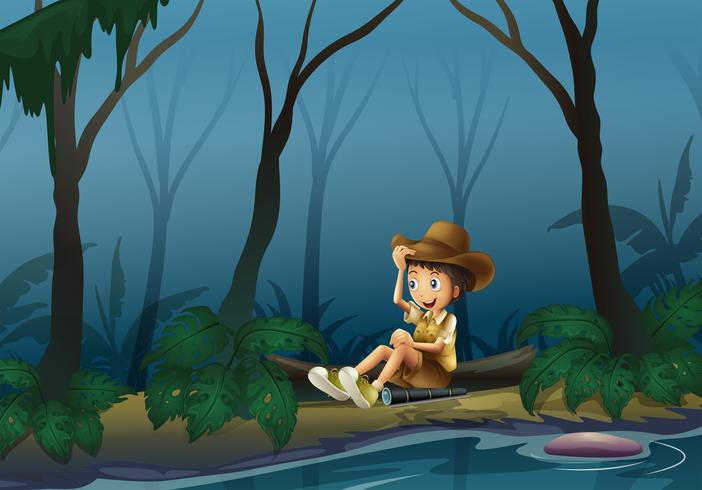 A male explorer relaxing near the riverbank
