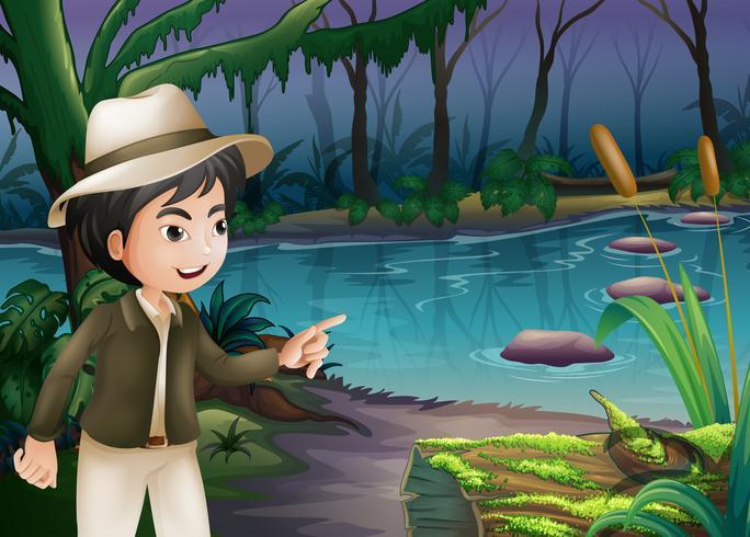 Un niño apuntando el tronco con algas.