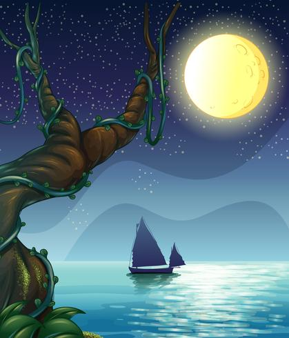 En båt seglar mitt på natten