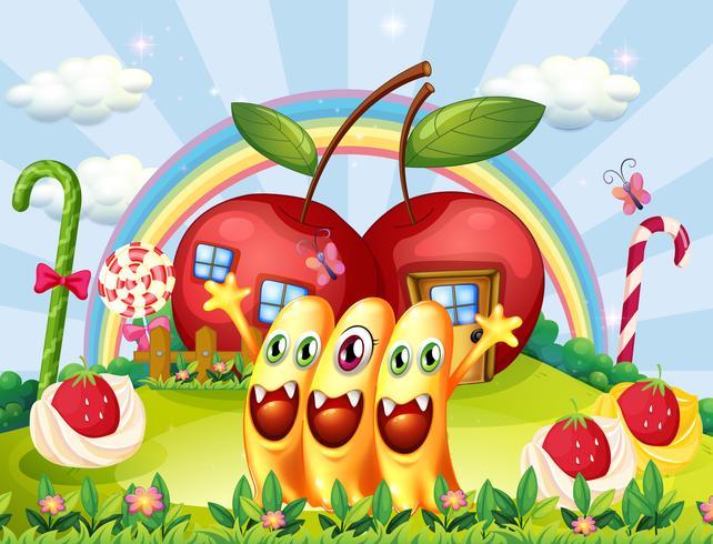 Drei Monster auf dem Hügel in der Nähe der Apfelhäuser