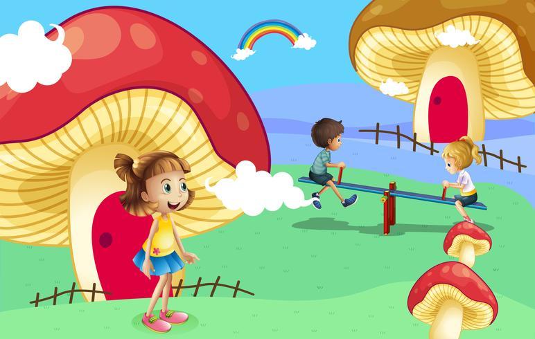 Bambini che giocano vicino alle case dei funghi giganti