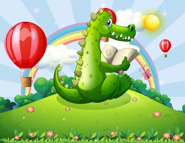 Un cocodrilo leyendo en la cima de una colina con un arco iris.