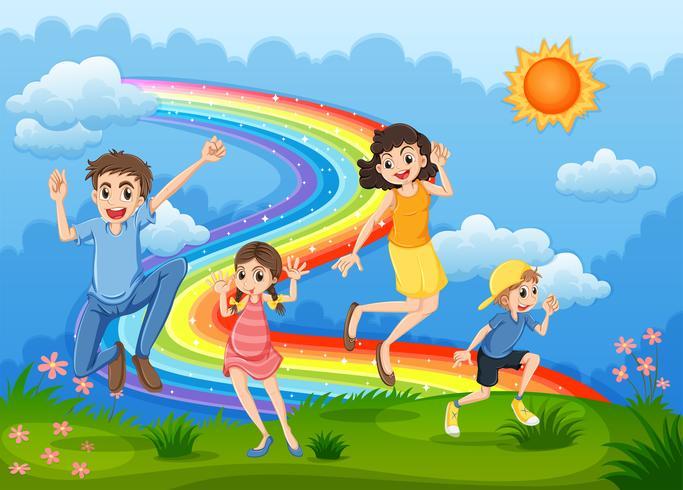 Uma família no topo da colina brincando com o arco-íris - Download ...