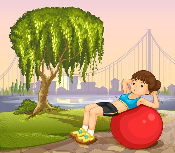 Une fille faisant de l'exercice près de la rivière