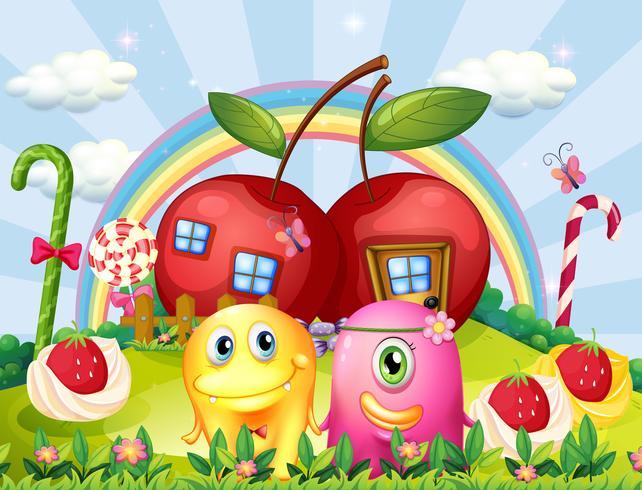Pareja de monstruos en la cima de la colina con un arco iris y casas de manzana.
