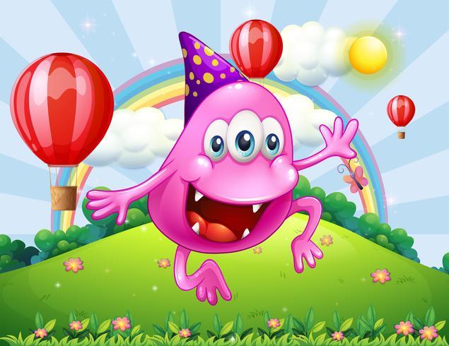 Un monstruo rosado feliz que salta en la cima de la colina.