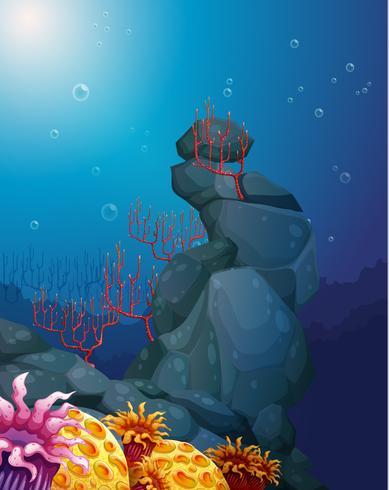 Una vista del mondo sotterraneo con rocce e barriere coralline vettore