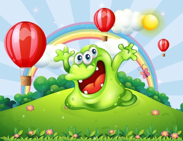 Een heuveltop met zwevende ballonnen en een groen monster
