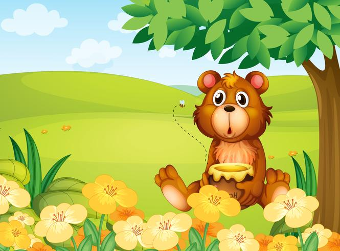 En björn håller en kruka med honung
