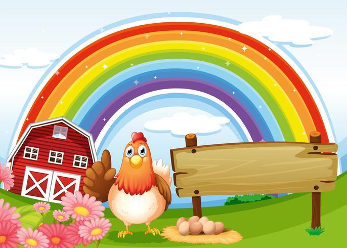 Una gallina accanto al tabellone vuoto della fattoria con un arcobaleno