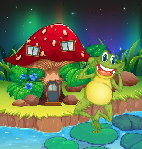 Una fastidiosa rana vicino alla casa dei funghi rossa