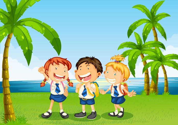 Tres alumnos en la orilla del río.