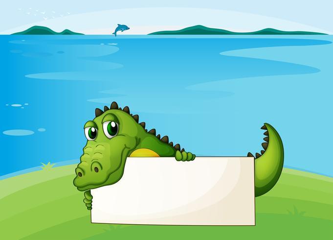 Un cocodrilo sosteniendo un letrero vacío.