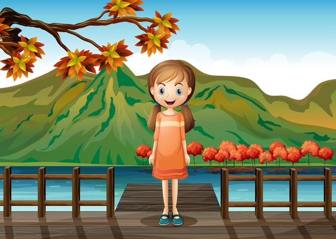 A young girl standing in the middle of the wooden bridge
