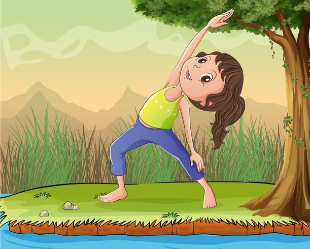 Una niña hace ejercicio debajo de un árbol.