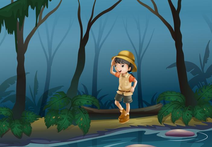 Una niña en medio del bosque cerca del río.