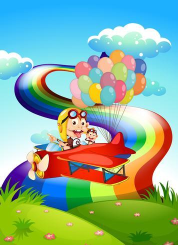 Scimmie giocose su un aereo con palloncini