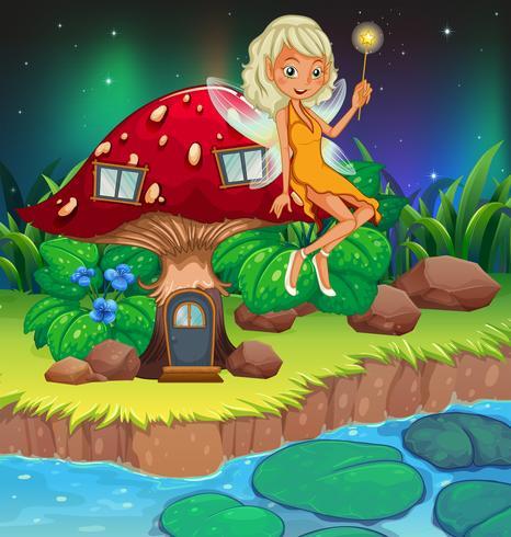 Una fata sopra la casa dei funghi rossa