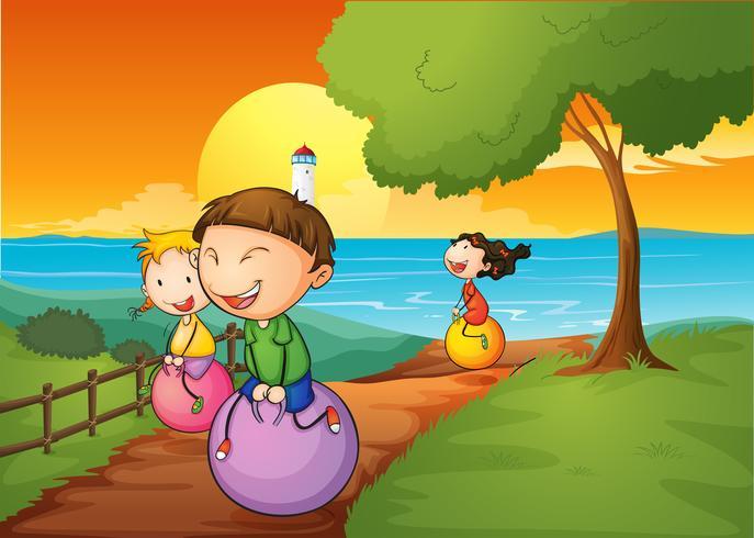 Feliz, crianças, tocando, com, a, saltando, bolas
