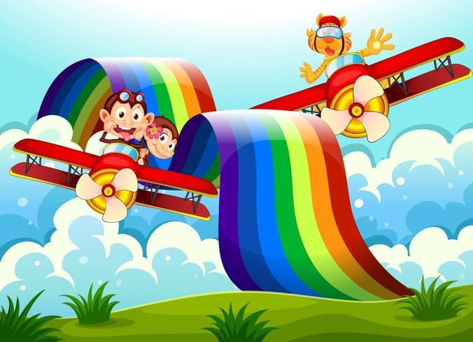 Verspielte Tiere in der Nähe des Regenbogens über den Hügeln