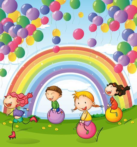 Niños jugando con globos flotantes y arco iris en el cielo.