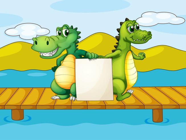 Två krokodiler med en tom kartong