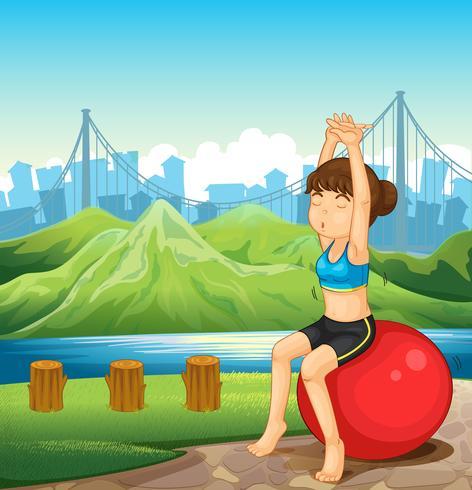 Una ragazza esercita vicino al fiume attraverso le montagne
