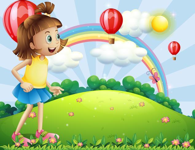 Una giovane ragazza in cima alla collina a guardare i palloni galleggianti