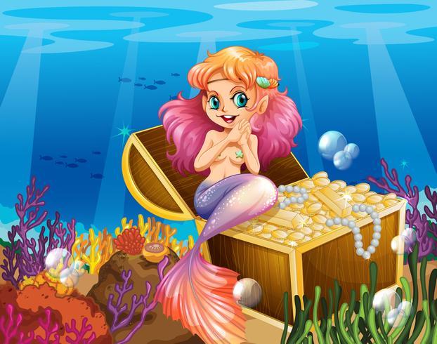 Una sirena sotto il mare accanto ai tesori