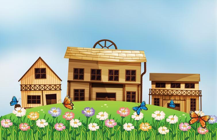 Tres casas de madera diferentes en la colina