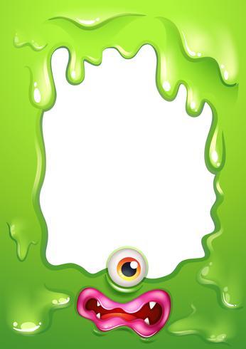 Een groen grenssjabloon met het oog en de lippen van een monster