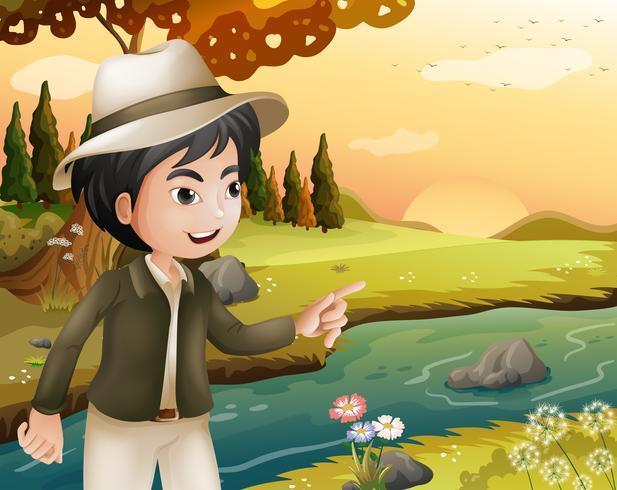 Un homme avec un chapeau au bord de la rivière