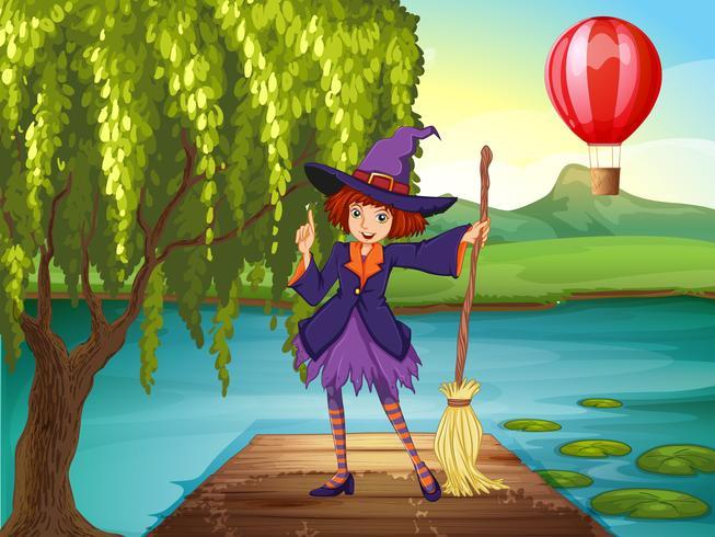 Una bruja sosteniendo una escoba parada en el puerto.