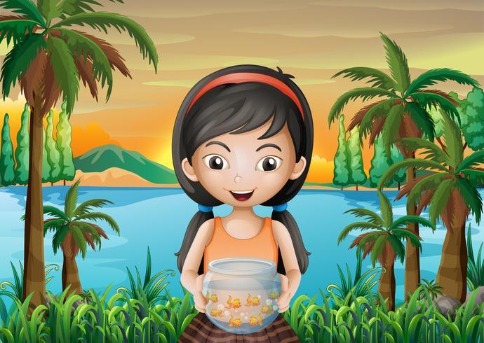 A girl holding an aquarium