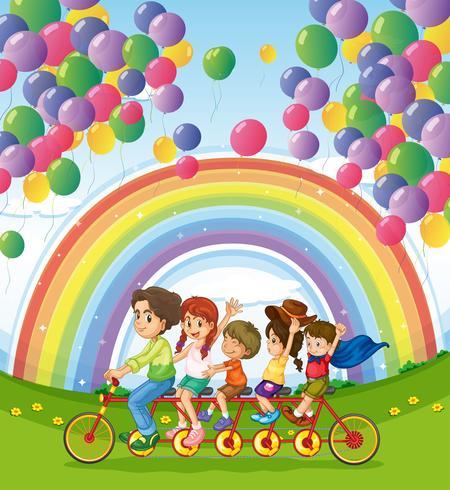 En fyrhjulig cykel under de flytande ballongerna nära regnbågen