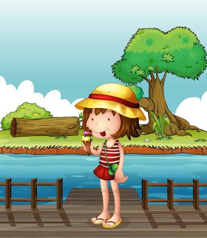 Une fille mange une glace au pont