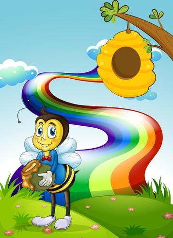 Uma colina com um arco-íris e uma abelha perto da colméia