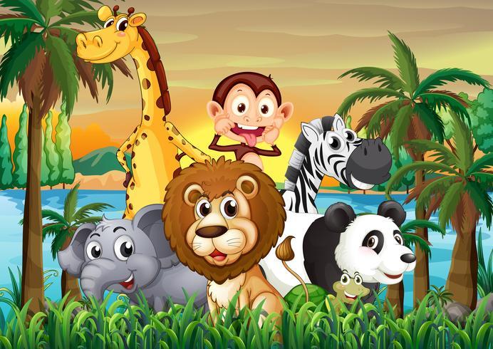Un grupo de animales en la orilla del río con árboles de coco.