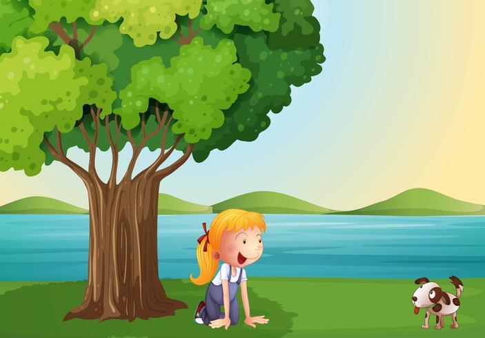 Una niña y su mascota cerca del árbol.