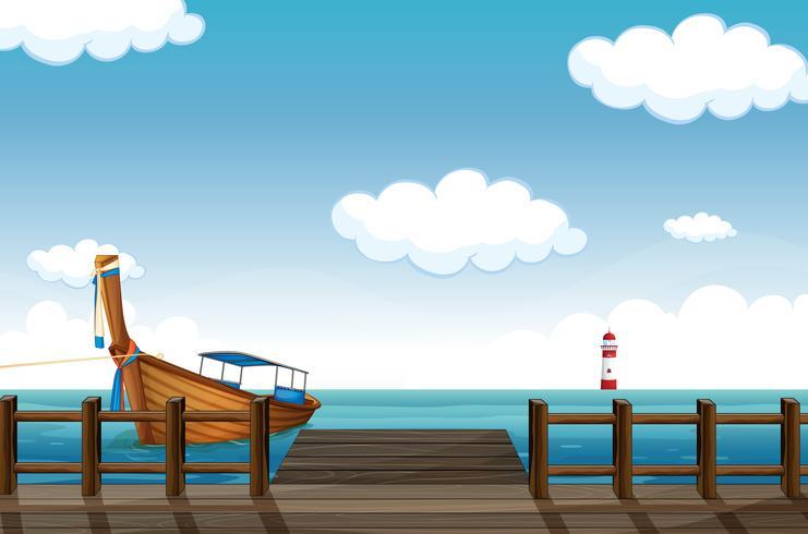 Un barco atracado y un faro.