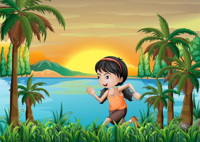 Una niña corriendo cerca del lago.