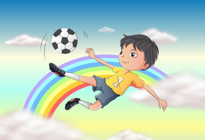 Um menino jogando futebol