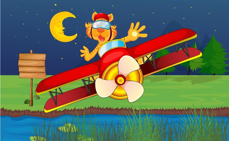 Een tijger die in een rood vliegtuig berijdt