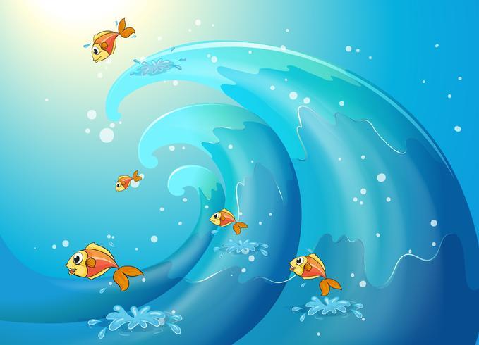 Peces bailando a lo largo de las grandes olas.