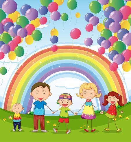 Una familia feliz bajo los globos flotantes con un arco iris.
