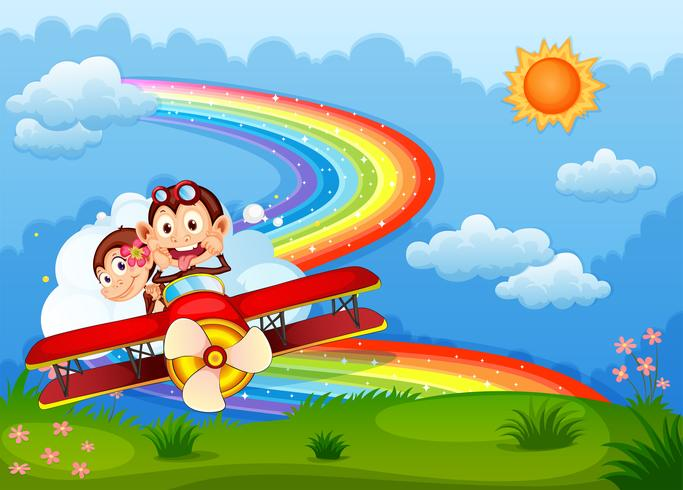 Un avion avec deux singes vantards et un arc-en-ciel dans le ciel