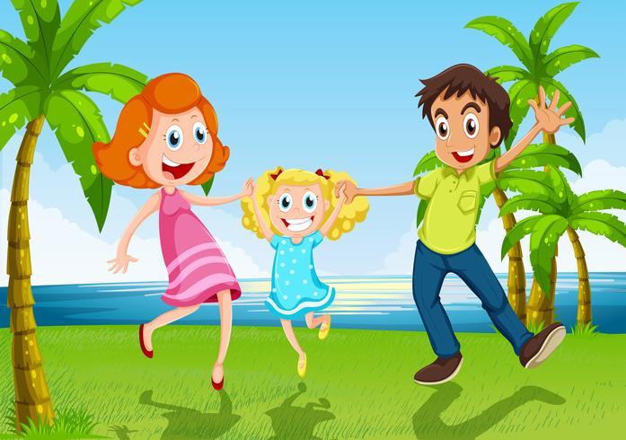 Una familia feliz bailando cerca del río.